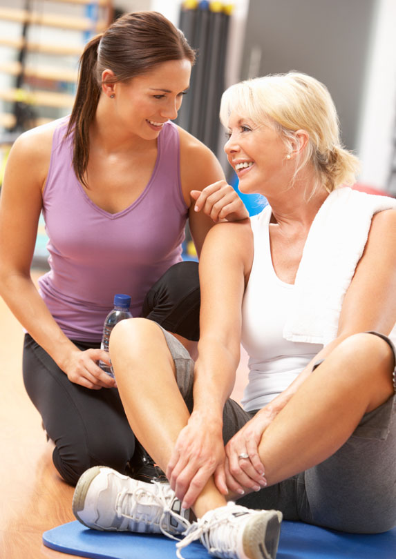 fitness instructor with woman