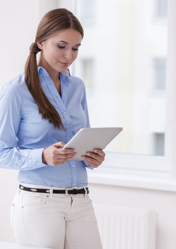 woman standing reading at work