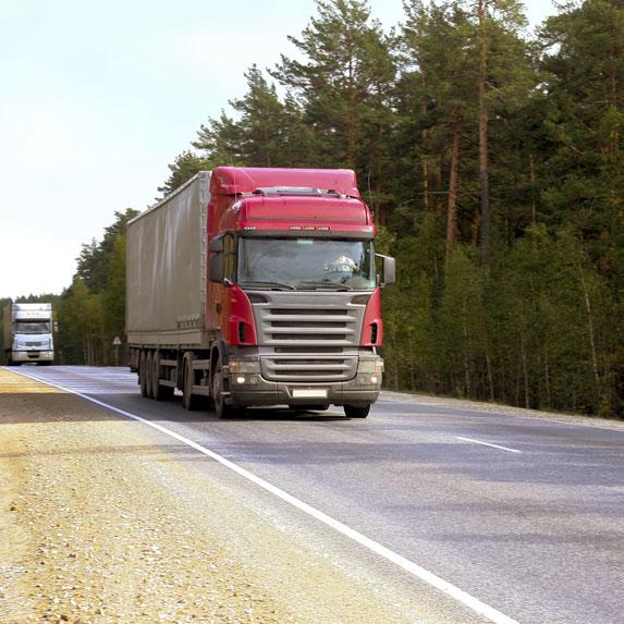 transport truck driving down road