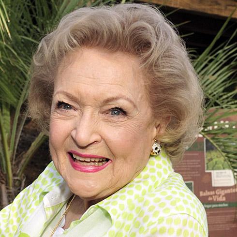 Betty White smiling in yellow shirt