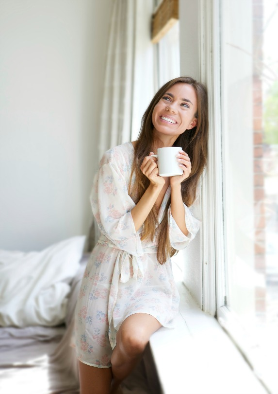woman smiling sipping coffee