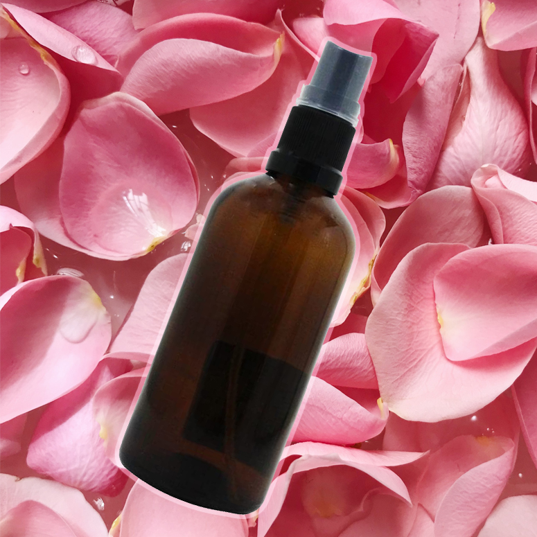 Spray Skincare bottle on background of rose petals