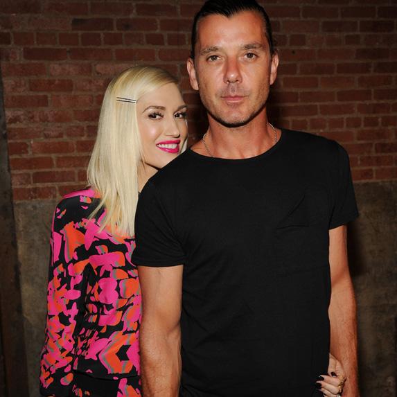 Gwen Stefani leaning on Gavin Rossdale, smiling