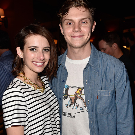 Emma Roberts and Evan Peters smiling at the cameras