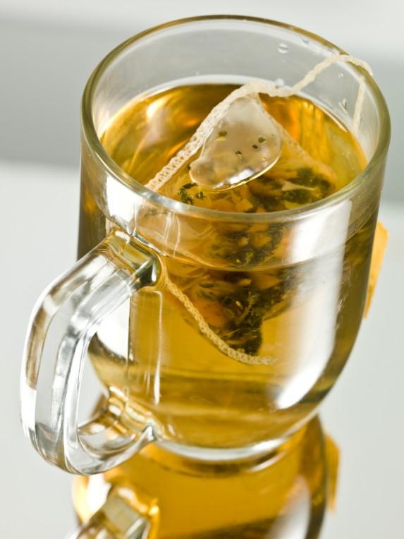 Clear mug with green tea bag