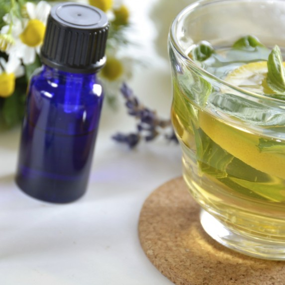 small vial of essential oil and steeped tea