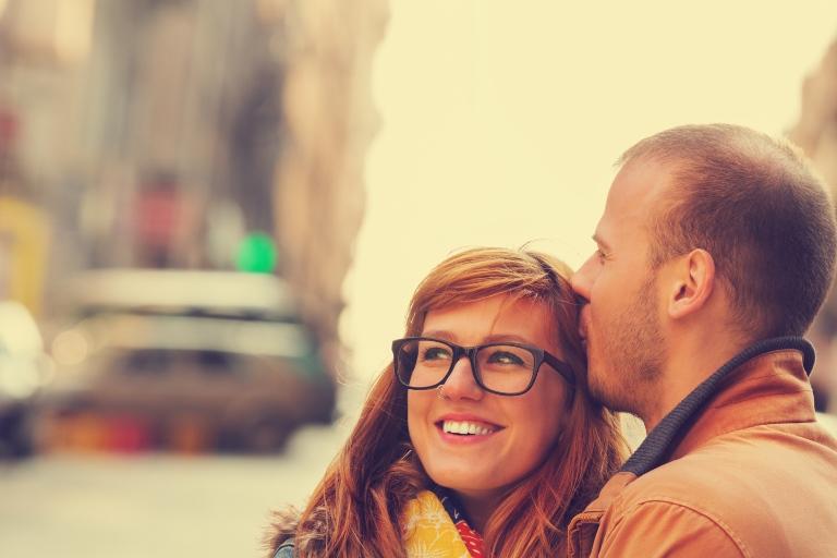 Guy kisses girl on the head