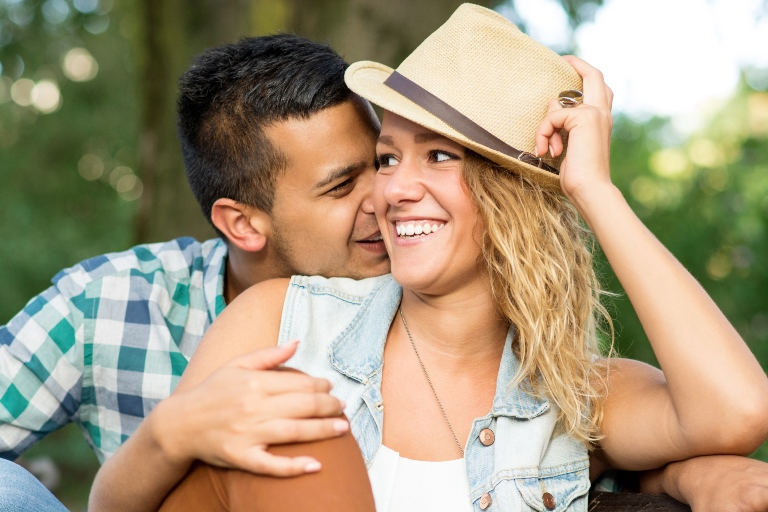 Guy leaning in to woman while she smiles