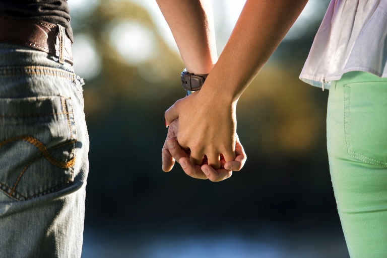 Closeup of holding hands