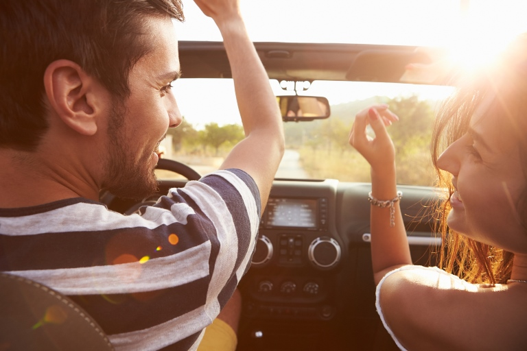 Couple excited in car