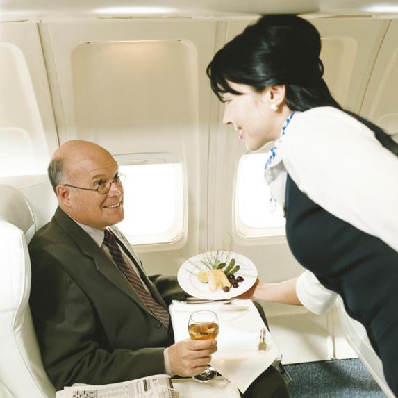 flight attendant serving a passenger