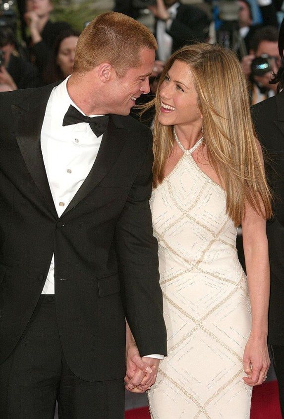 Brad Pitt and Jennifer Aniston gazing at each other lovingly on the red carpet