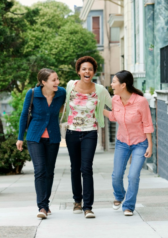 happy women walking together laughing