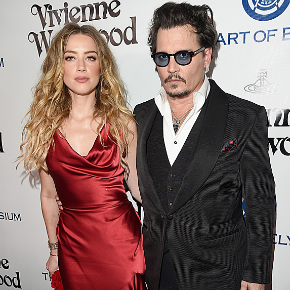 Amber Heard and Johnny Depp at a red carpet event, dressed up