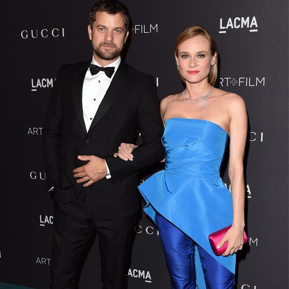 Diane Kruger and Joshua Jackson posing together, dressed up