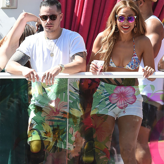 Jennifer Lopez and Casper Smart at an outdoor party, in summer outfits
