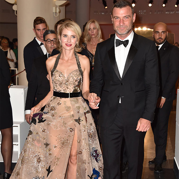 Naomi Watts and Liev Schreiber walking towards the camera at an event, all dressed up