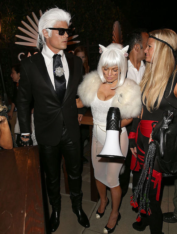 Fergie and Josh Duhammel dressed as Karl Lagerfeld and his pet cat for Halloween