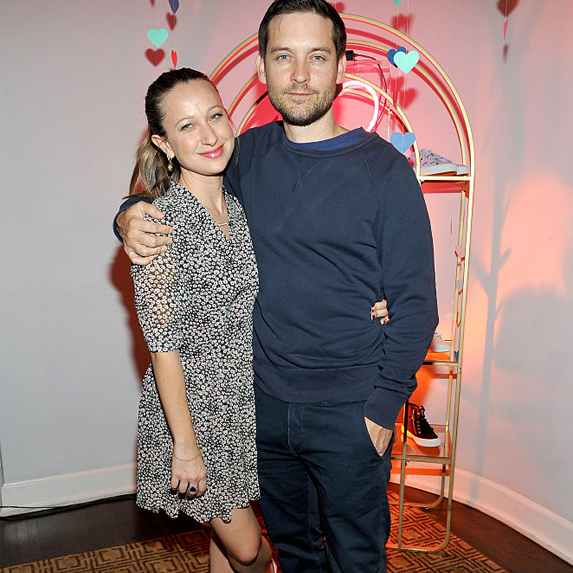 Tobey Maguire and Jennifer Meyer, standing arm in arm break up
