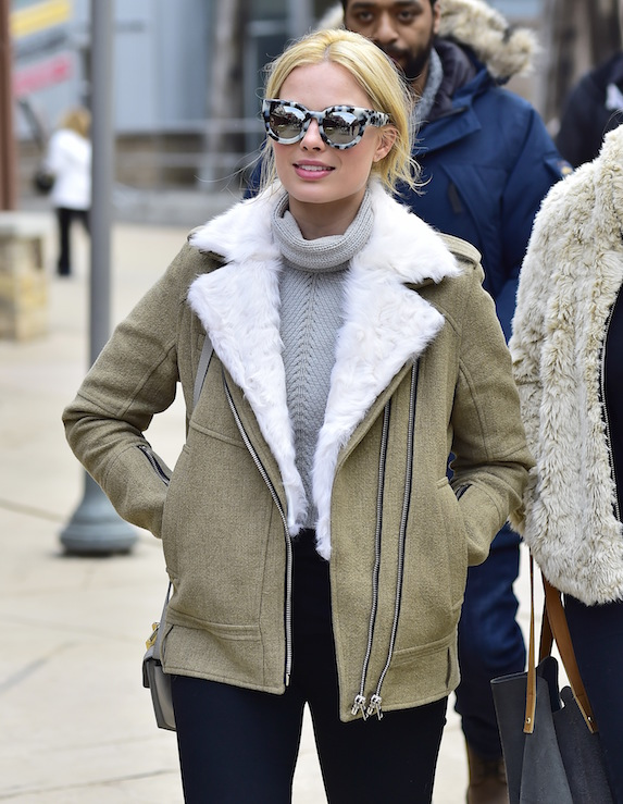 Margot Robbie wears an oversized aviator coat