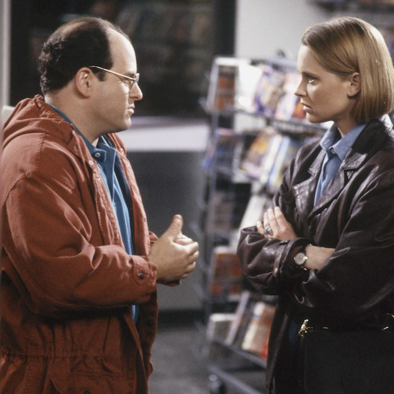 Jason Alexander and Heidi Swedberg mid-scene