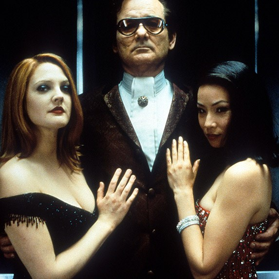 Bill Murray standing with Drew Barrymore and Lucy Liu
