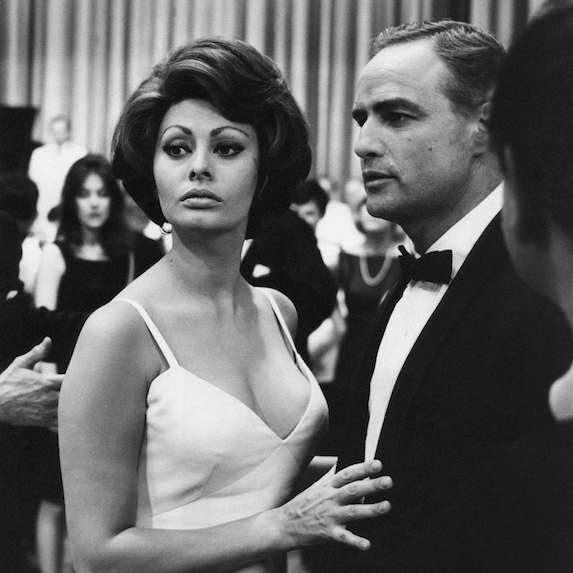 A black-and-white image of Marlon Brando and Sophia Loren