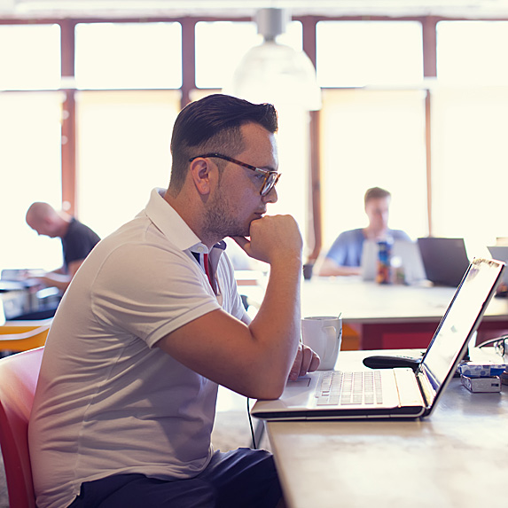 DevOps engineer working on laptop