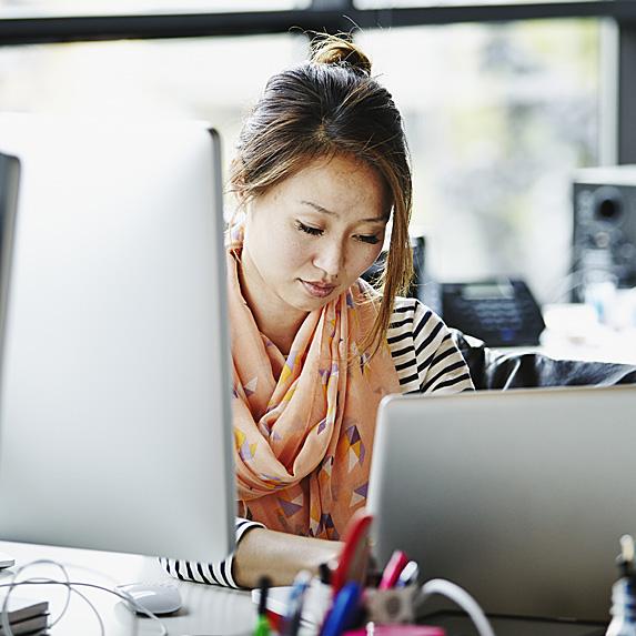 Female social media manager at computer