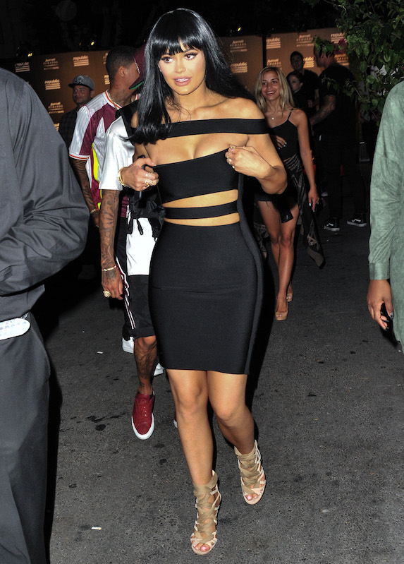 Kylie Jenner black dress with weird straps