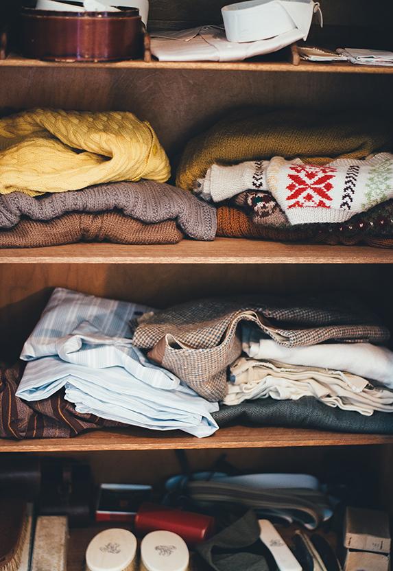 sweaters on a shelf
