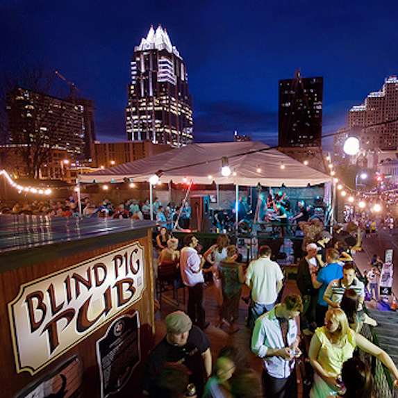 Pub in Austin, Texas with twinkling lights and people dancing on outdoor patio