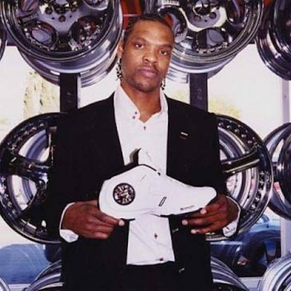 Latrell Sprewell posing with shoe