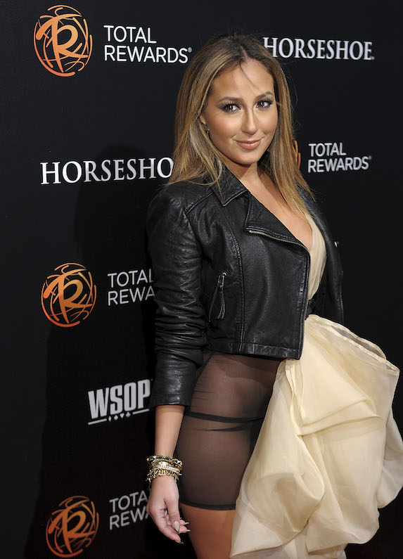 Adrienne Bailon walks the red carpet at the 43rd Annual Daytime Emmy Awards