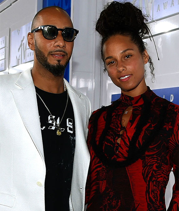 Alicia Keys and Swizz Beatz pose on the red carpet