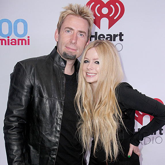 Avril Lavigne and Chad Kroeger smile on the red carpet