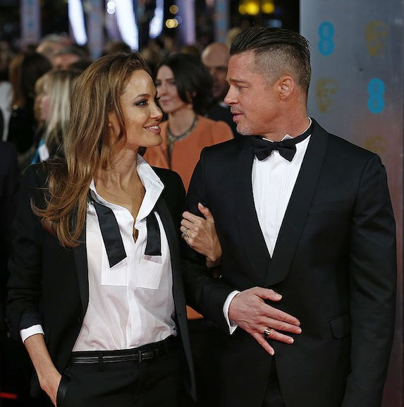 Brad Pitt and Angelina Jolie in matching tuxedoes
