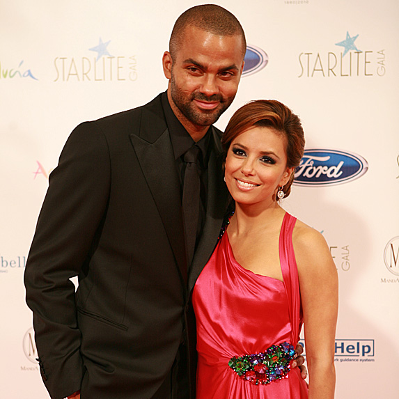 Eva Longoria in a red dress and Tony Parker in an all-black tux smile for the camera