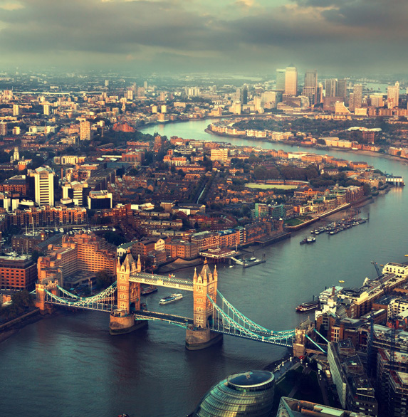 Overhead views of the water and cityscape in London, England with emphasis on the city's famed Tower Bridge