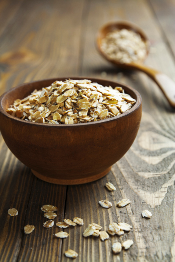 Oats in a wooden bowl.