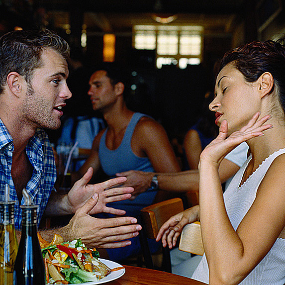Man and woman in an argument at a restaurant