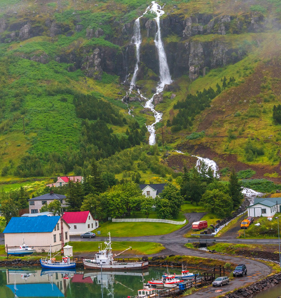 Seaside and lush green mountain views in Iceland