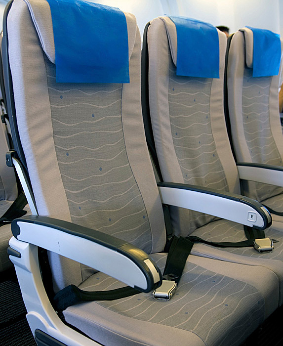 Row of empty seats on an airplane