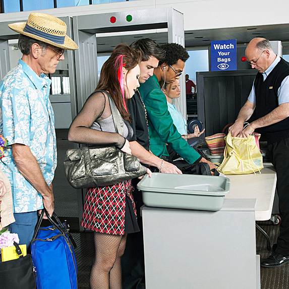 Group of people going through airport security at the airport