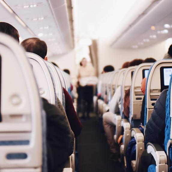 Passengers seated on airplane