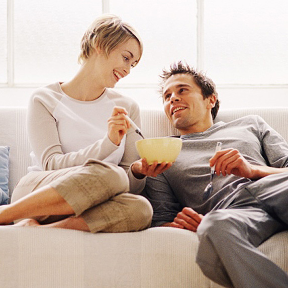 Woman and man eating cereal