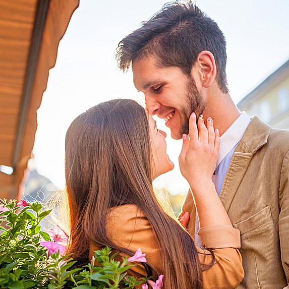 Woman and man about to kiss