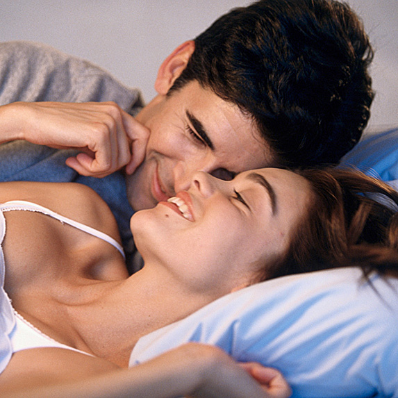 Man and woman waking up in bed
