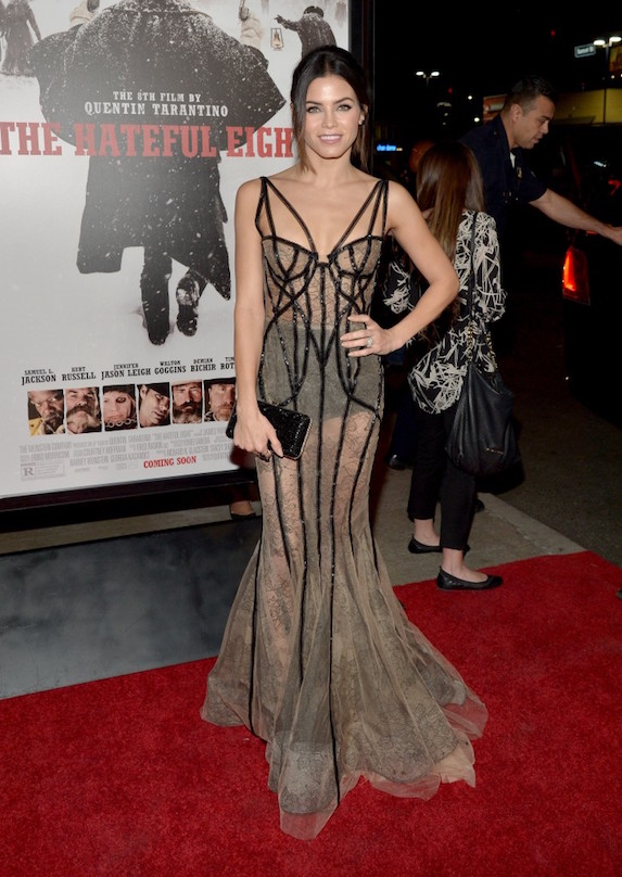Actress Jenna Dewan-Tatum poses at The Hateful Eight premiere in a floor length nude gown with sheer details and black piping throughout