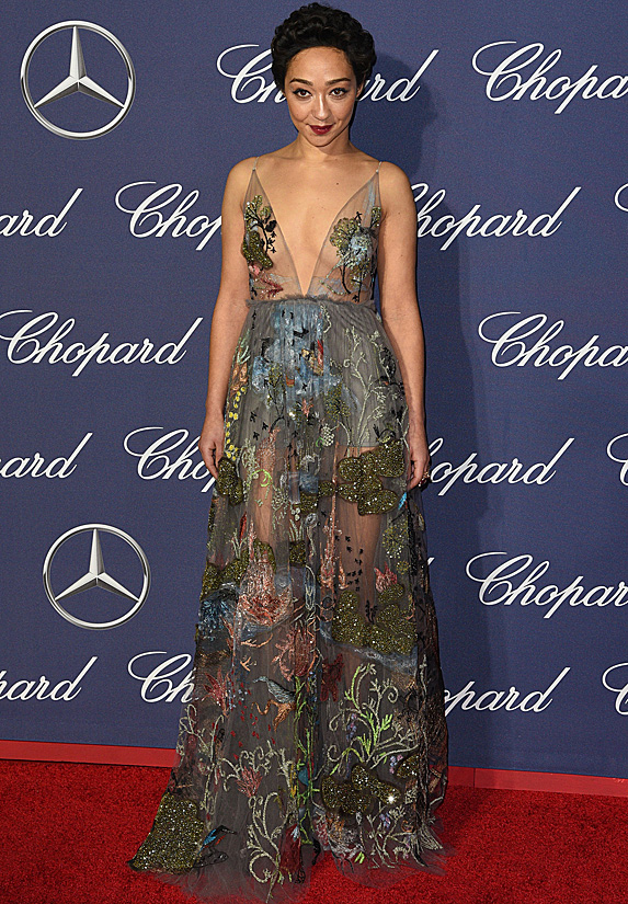 Actress Ruth Negga poses in a sheer and floral embroidered gown